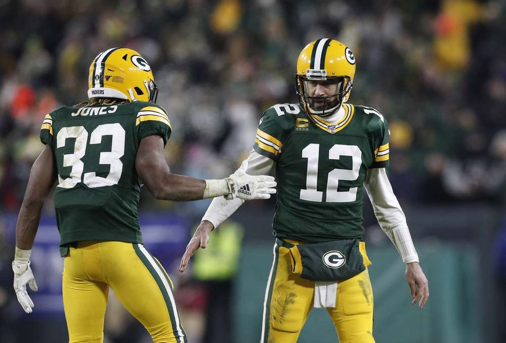 Aaron Rodgers and Aaron Jones playing for Green Bay in the Divsional Round