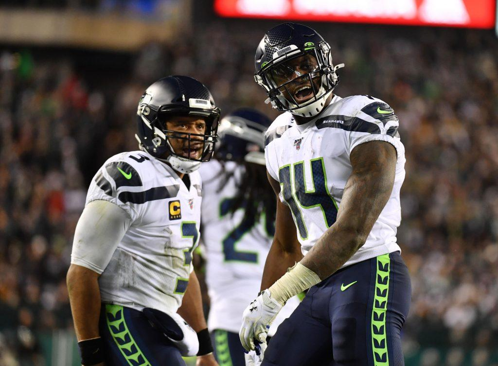 Russell Wilson and DK Metcalf playing for Seattle Seahawks