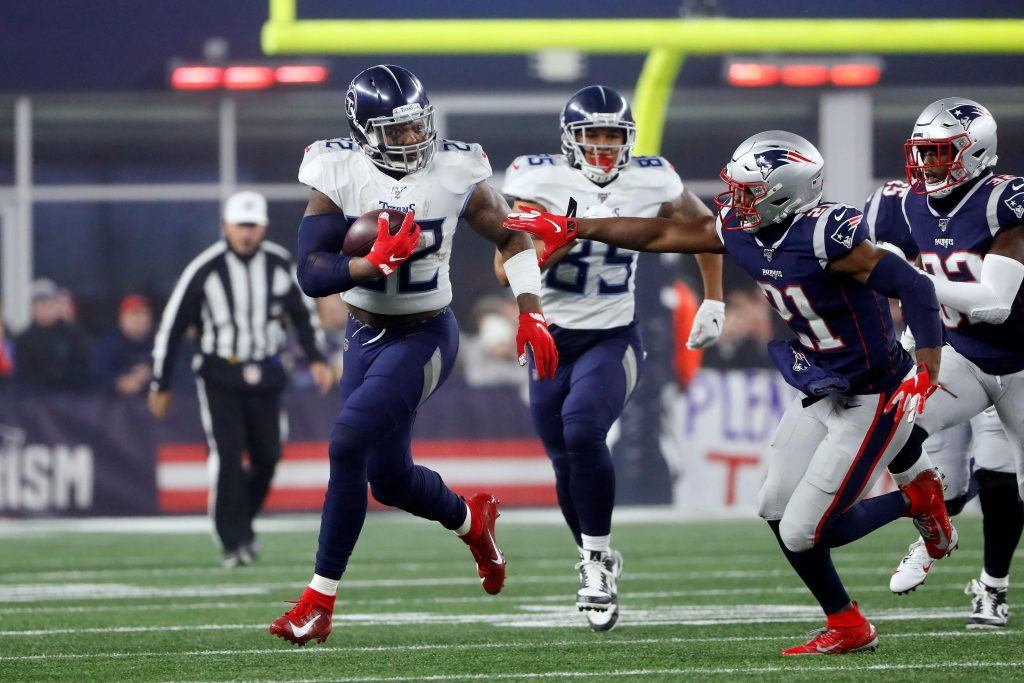 Derrick Henry (22) runs against New England Patriots strong safety Duron Harmon (21)