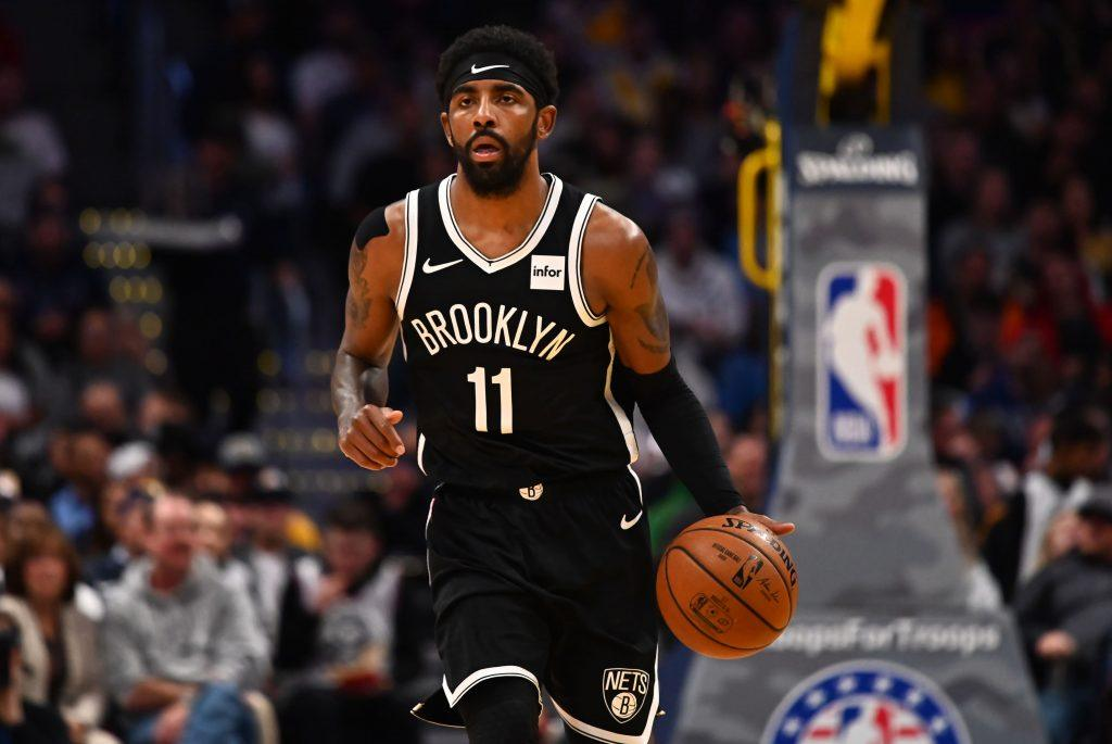 Kyrie Irving of the Brooklyn Nets takes the ball up court.