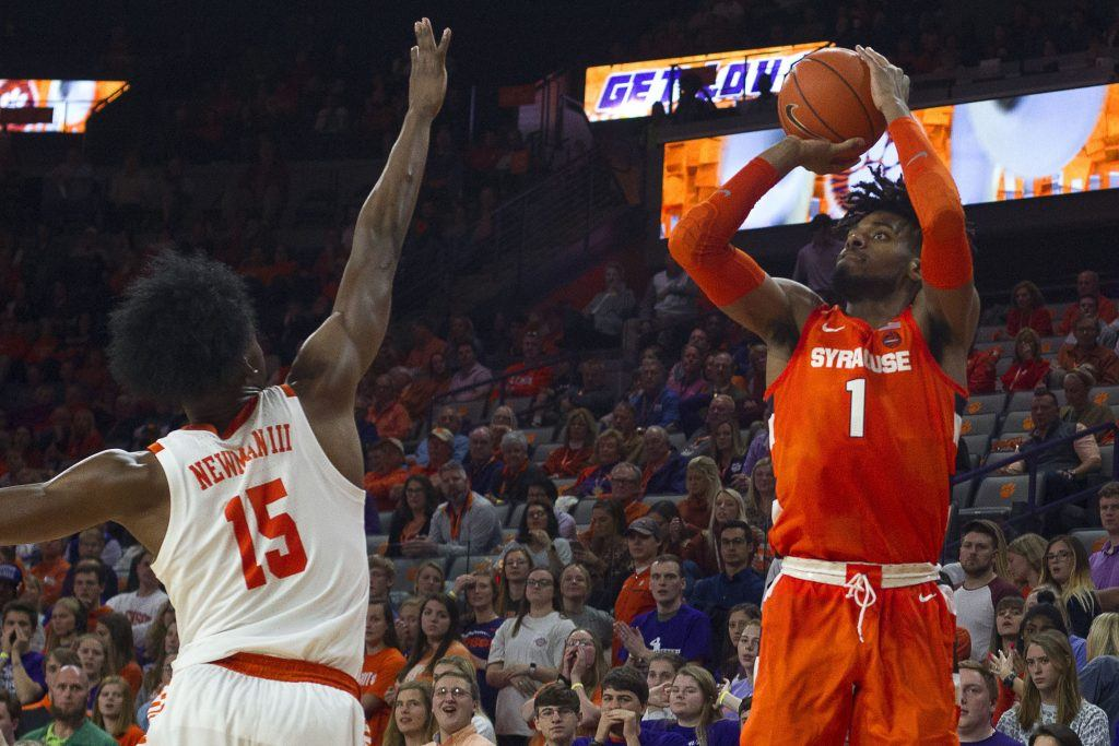Syracuse's Quincy Guerrier looks to shoot over Clemson's John Newman