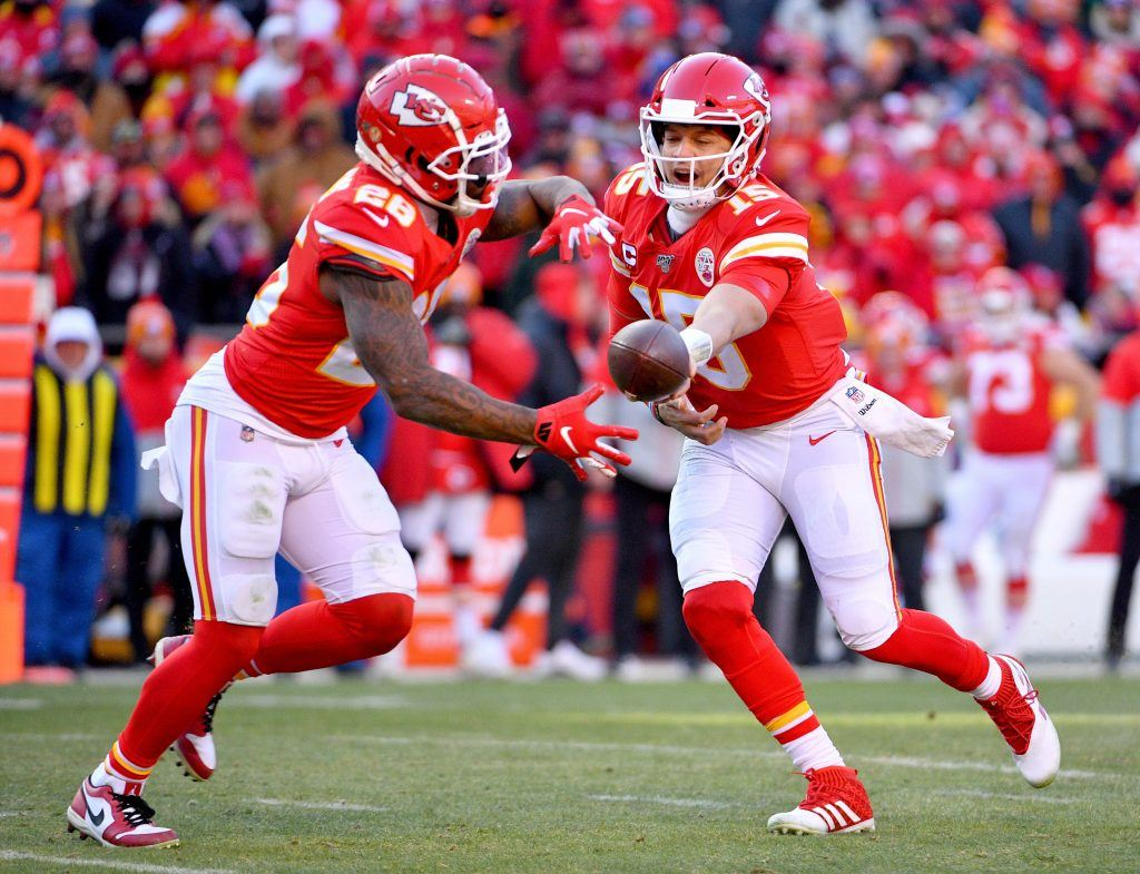 Patrick Mahomes of the Kansas City Chiefs hands the ball off to Damien Williams.
