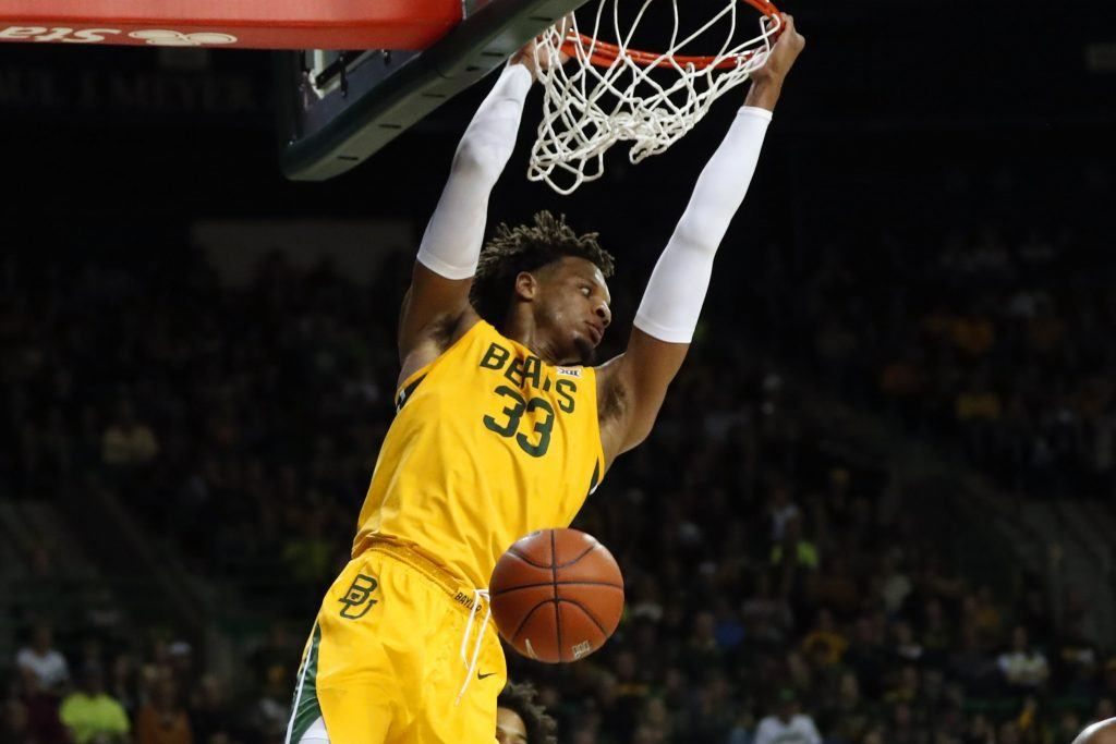 Baylor's Freddie Gillespie hangs on rim after dunking