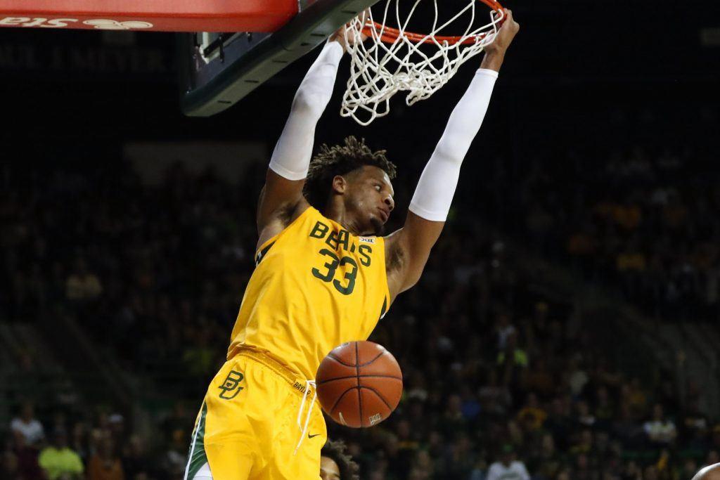 Baylor's Freddie Gillespie hangs on rim after dunking