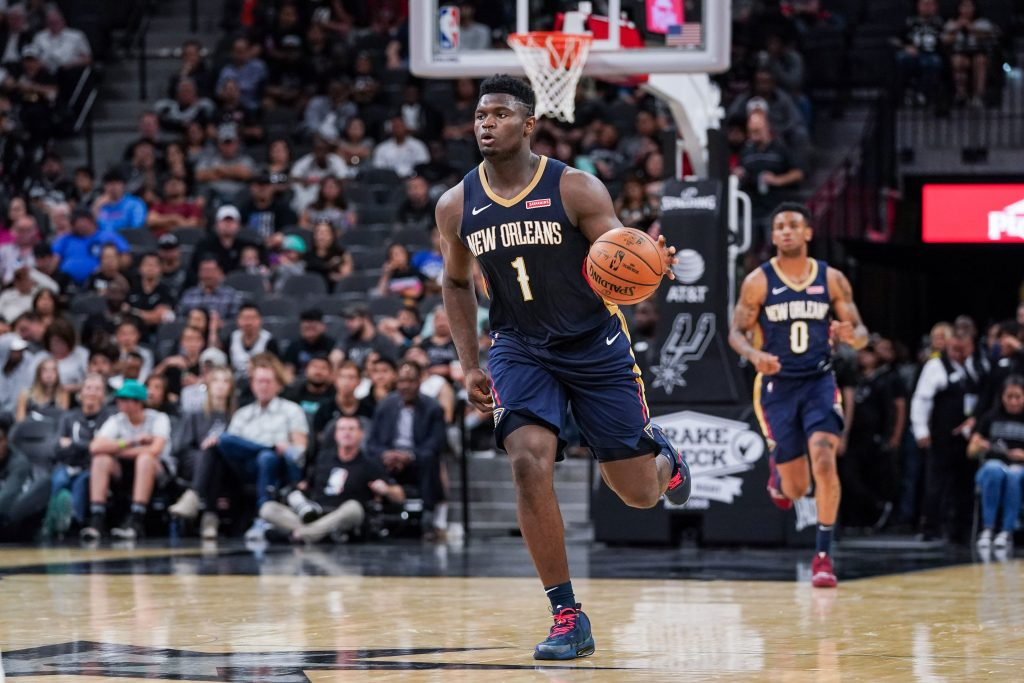 Zion Williams of the New Orleans Pelicans dribbles the ball up the court.