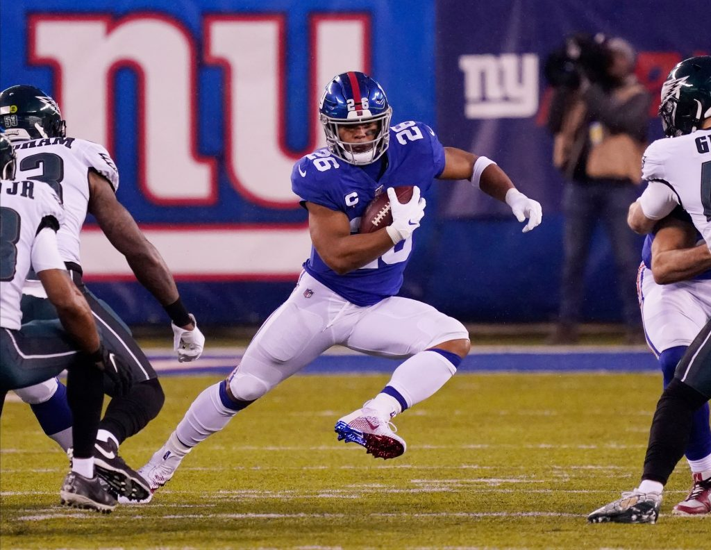 New York Giants running back Saquon Barkley runs up the field.