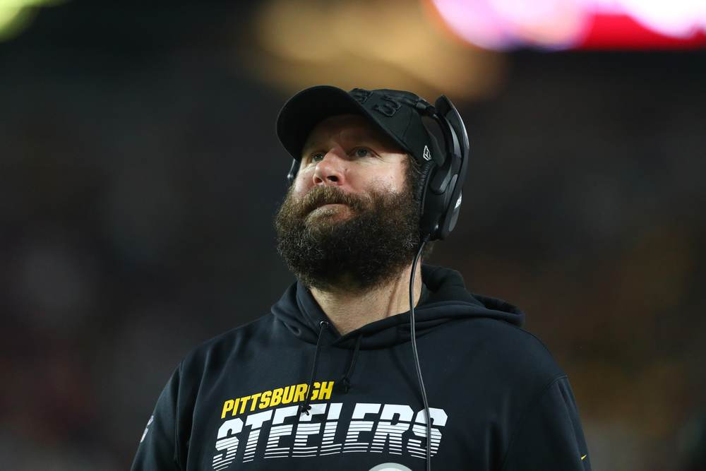 An injured Ben Roethlisberger roams the sidelines during a Pittsburgh Steelers game.