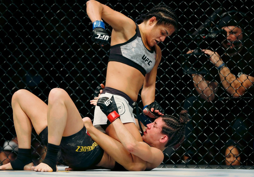 Marina Rodriguez (red gloves) fights Cynthia Calvillo (blue gloves) during UFC Fight Night at Capital One Arena.