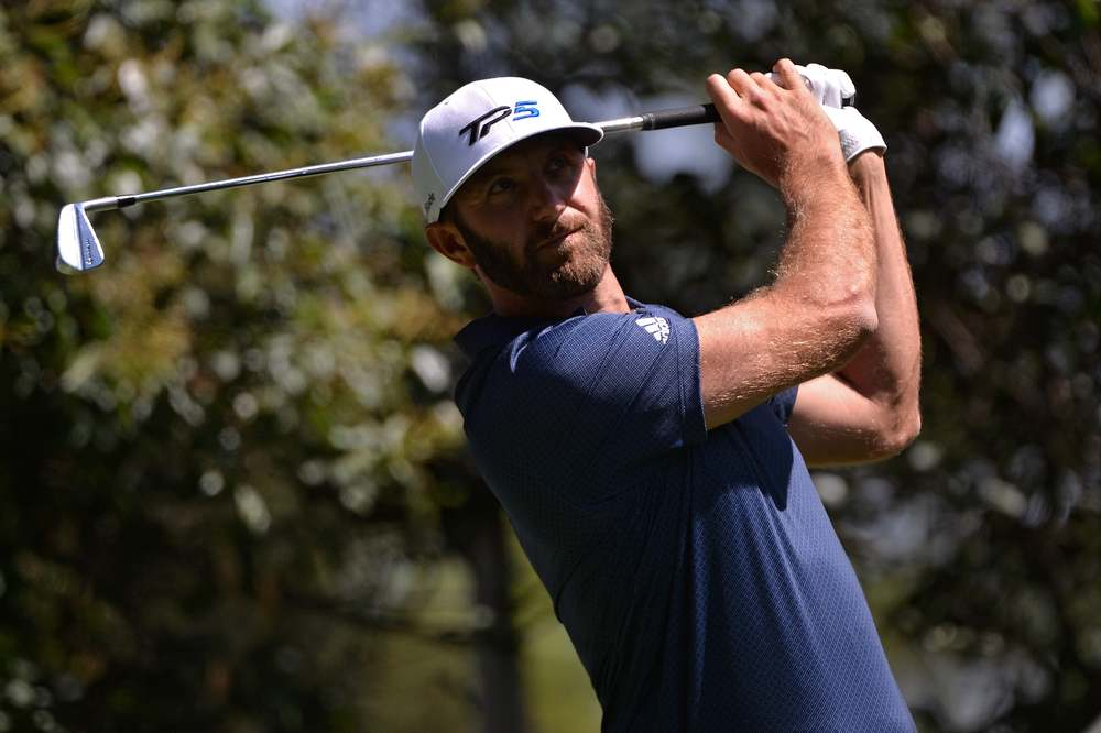 Dustin Johnson hits a shot at the 2020 WGC-Mexico.