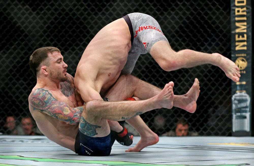 Grant Dawson (red gloves) fights Darrick Minner (blue gloves) during UFC Fight Night at Chartway Arena.