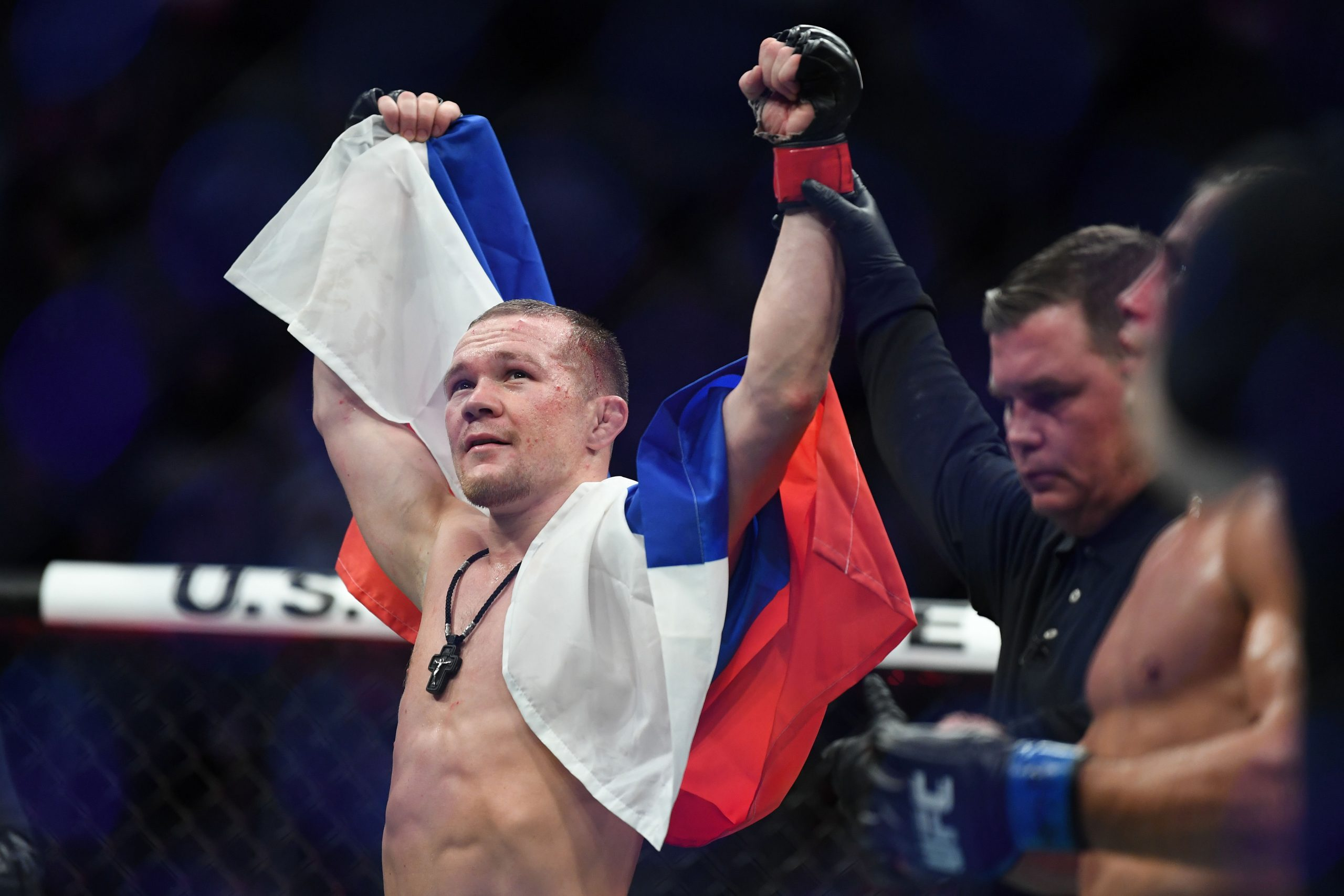 Dec 14, 2019; Las Vegas, NV, USA; Petr Yan (red gloves) reacts after defeating Urijah Faber (blue gloves) during UFC 245 at T-Mobile Arena.