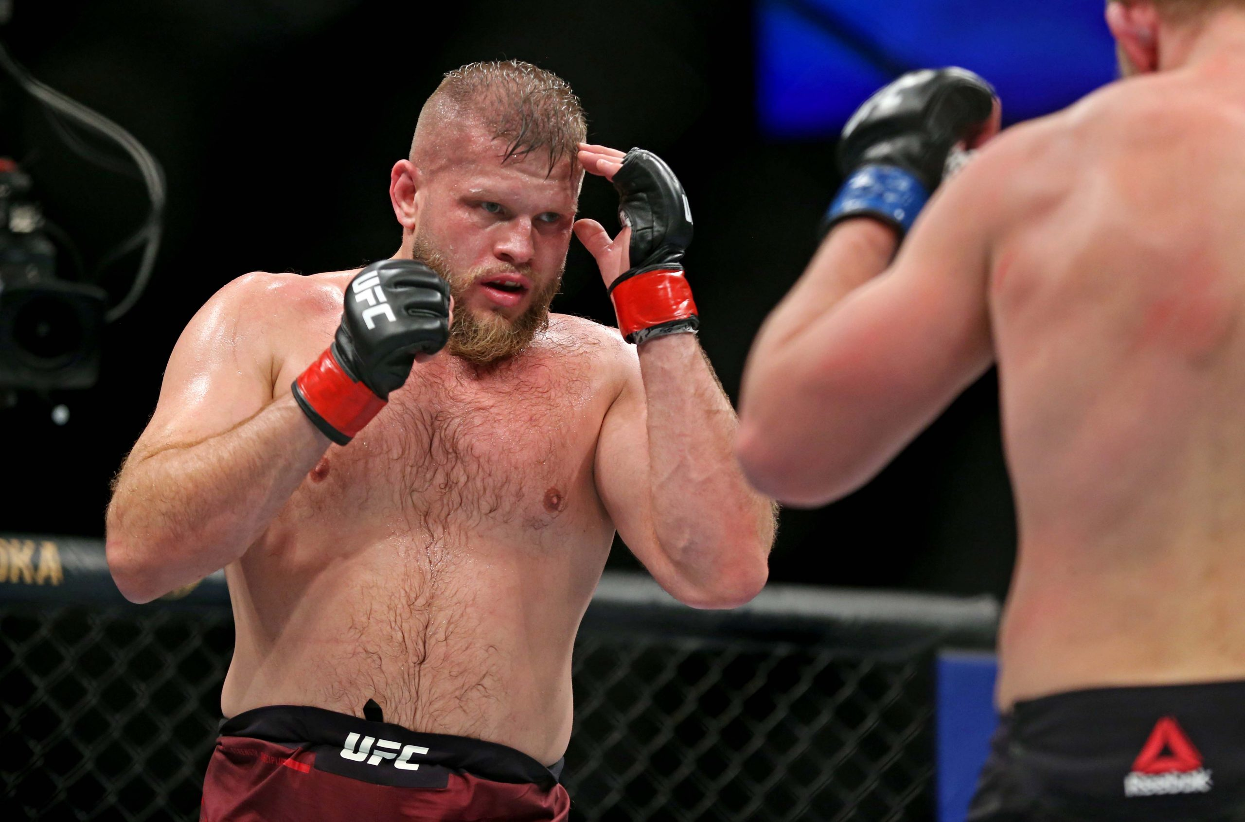 Feb 29, 2020; Norfolk, Virginia, USA; Marcin Tybura (red gloves) fights Serghei Spivac (blue gloves) during UFC Fight Night at Chartway Arena.