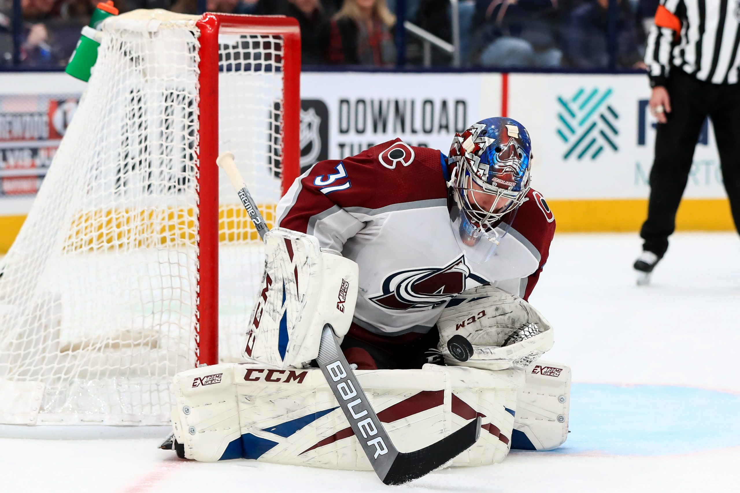 Philipp Grubauer (31) makes a save in net