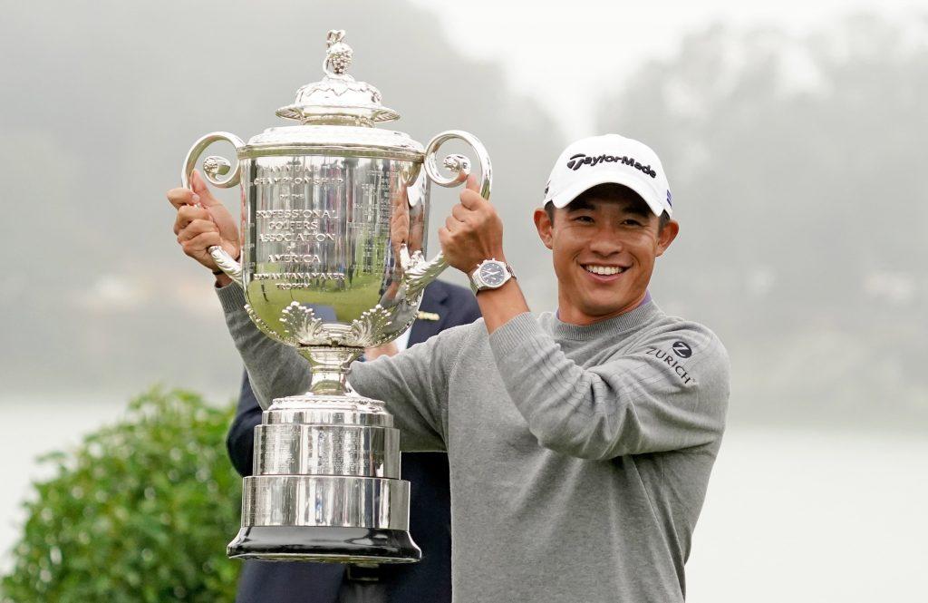 Collin Morikawa lifts the PGA Championship trophy.