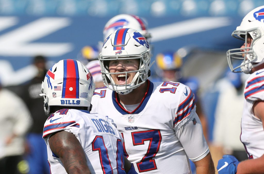 Bills quarterback Josh Allen celebrating after receiver Stefon Diggs' four-yard touchdown catch in a 35-32 win over the Rams.