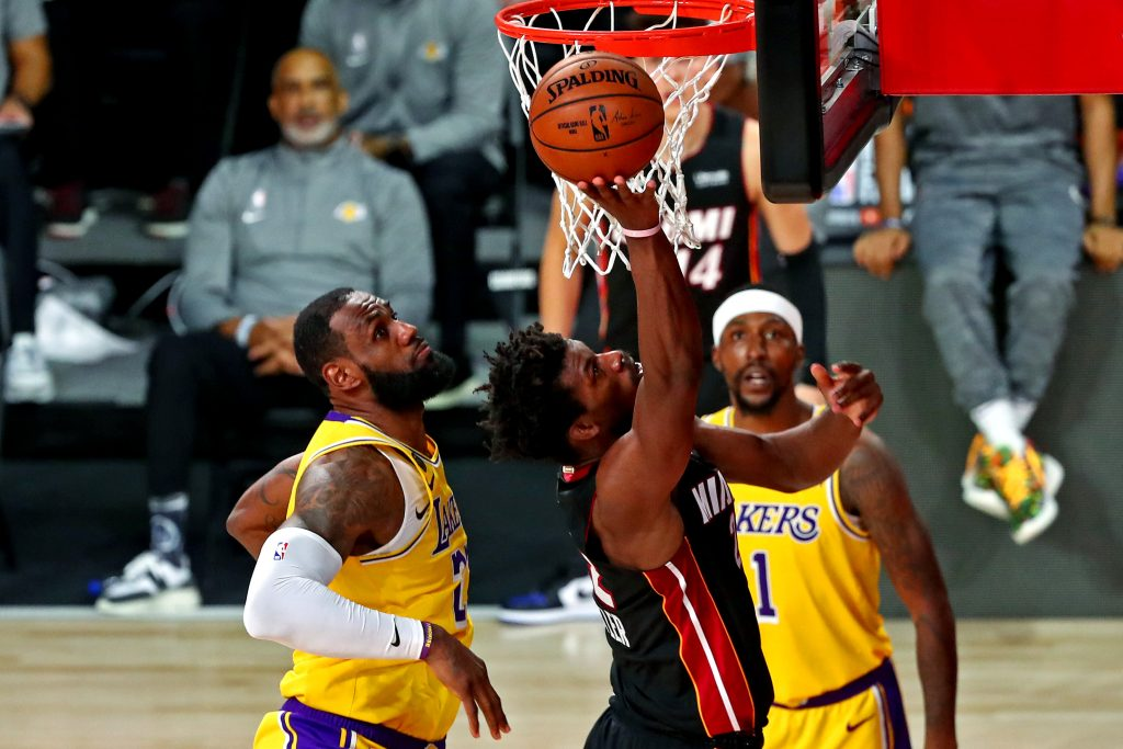 Miami Heat forward Jimmy Butler shoots the ball against Los Angeles Lakers forward LeBron James during the fourth quarter in Game 4 of the 2020 NBA Finals at AdventHealth Arena.