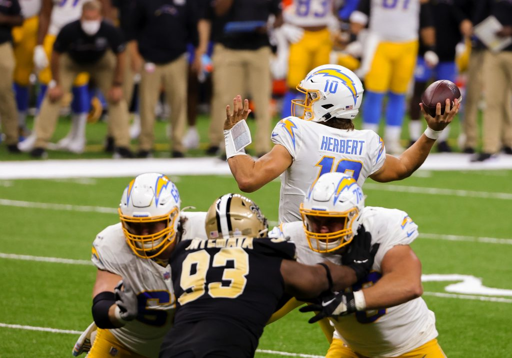 Justin Herbert attempts a pass during the Los Angeles Chargers' Monday Night Football loss to the New Orleans Saints