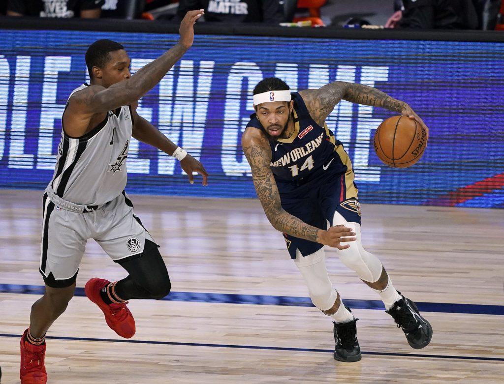 New Orleans Pelicans Forward Brandon Ingram dribbles past defender in game against San Antonio Spurs