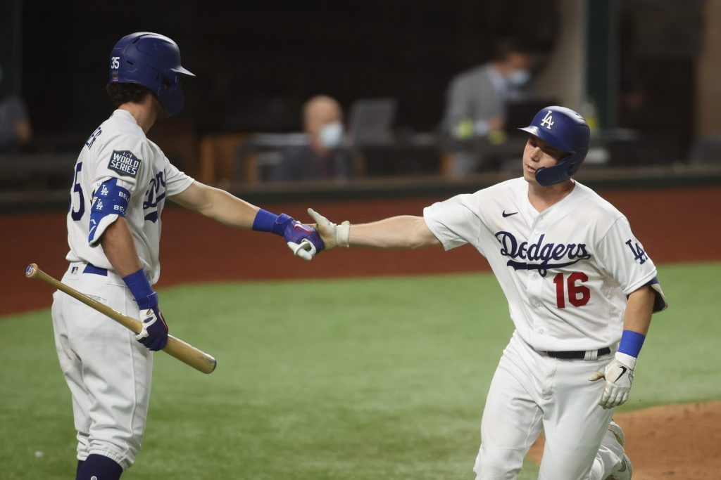 Los Angeles Dodgers catcher Will Smith celebrates with outfielder Cody Bellinger during World Series game against the Tampa Bay Rays
