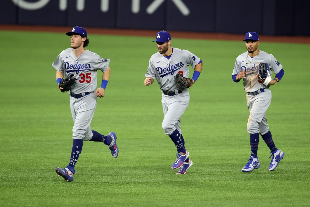 Los Angeles Dodgers outfielders Mookie Betts, Cody Bellinger, and Chris Taylor jog in during World Series against Tampa Bay Rays
