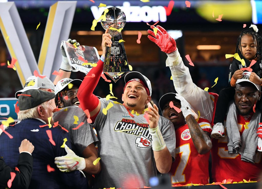 Kansas City Chiefs quarterback Patrick Mahomes (15) hoist the Vince Lombardi Trophy after defeating the San Francisco 49ers in Super Bowl LIV at Hard Rock Stadium.