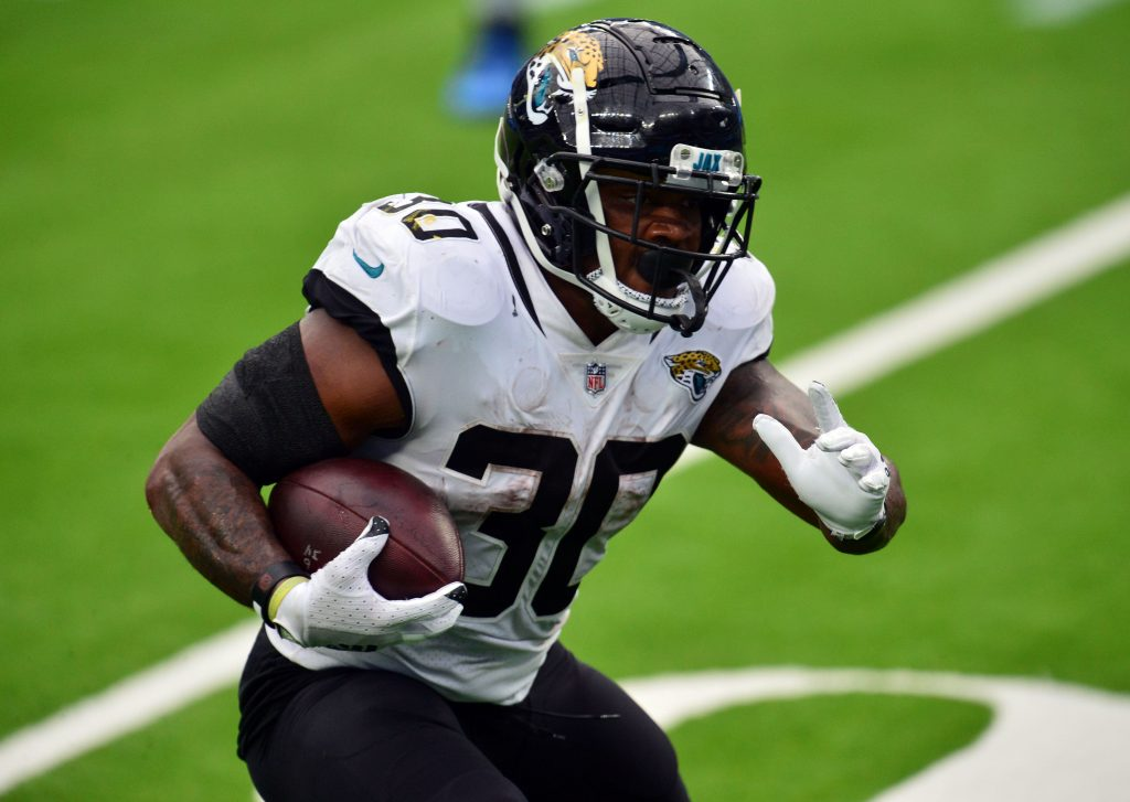 Jacksonville Jaguars running back James Robinson (30) runs the ball against the Los Angeles Chargers during the first half at SoFi Stadium.