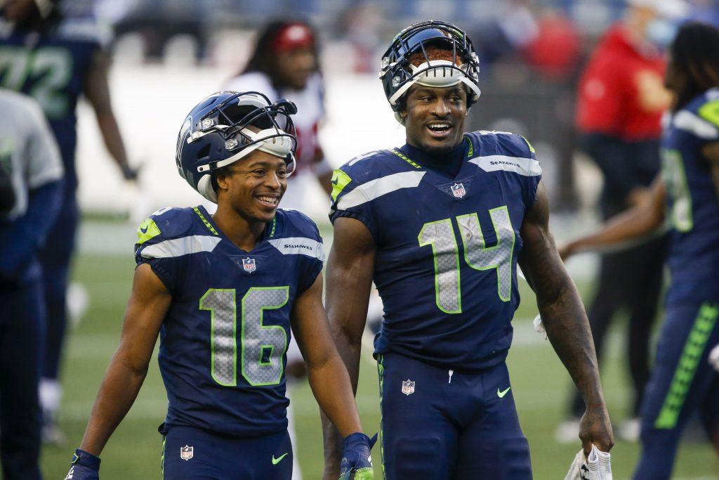 Seattle Seahawks wide receiver Tyler Lockett (16) and wide receiver DK Metcalf (14) return to the locker room following a 37-27 victory against the San Francisco 49ers at CenturyLink Field.