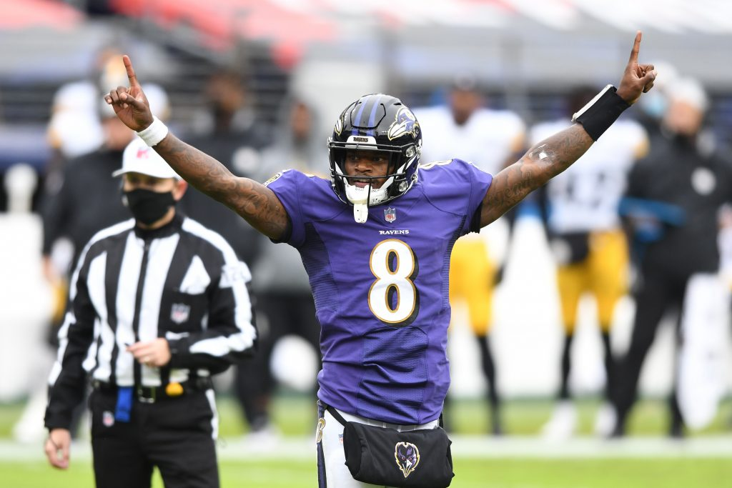 Baltimore Ravens quarterback Lamar Jackson (8) celebrates after a touchdown against the Pittsburgh Steelers