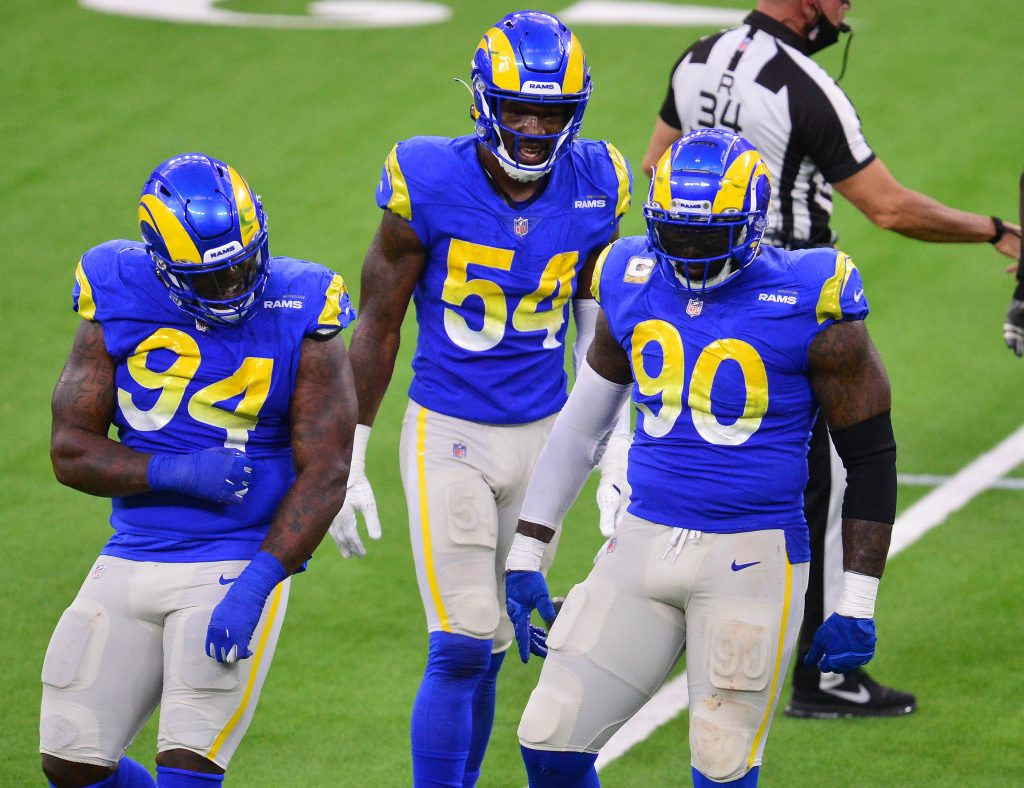 Los Angeles Rams defensive end Michael Brockers (90) reacts with defensive end Rasheem Green (94) after sacking Seattle Seahawks quarterback Russell Wilson (3).