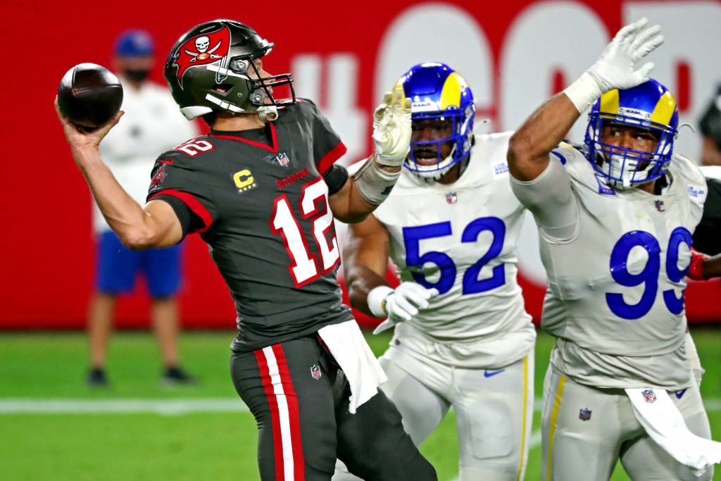Tampa Bay Buccaneers quarterback Tom Brady is chased by Los Angeles Rams defensive tackle Aaron Donald