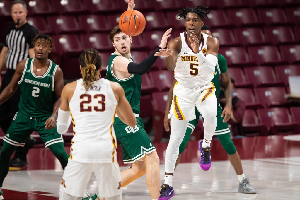 Minnesota Golden Gophers guard Marcus Carr passes the ball during win over Green Bay