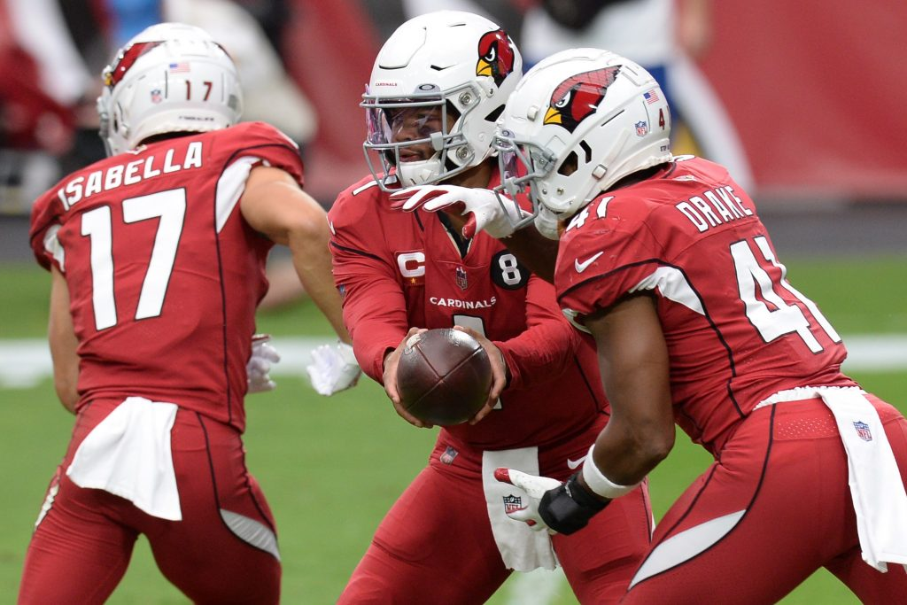Kyle Murray of the Arizona Cardinals hands the ball off to Kenyan Drake