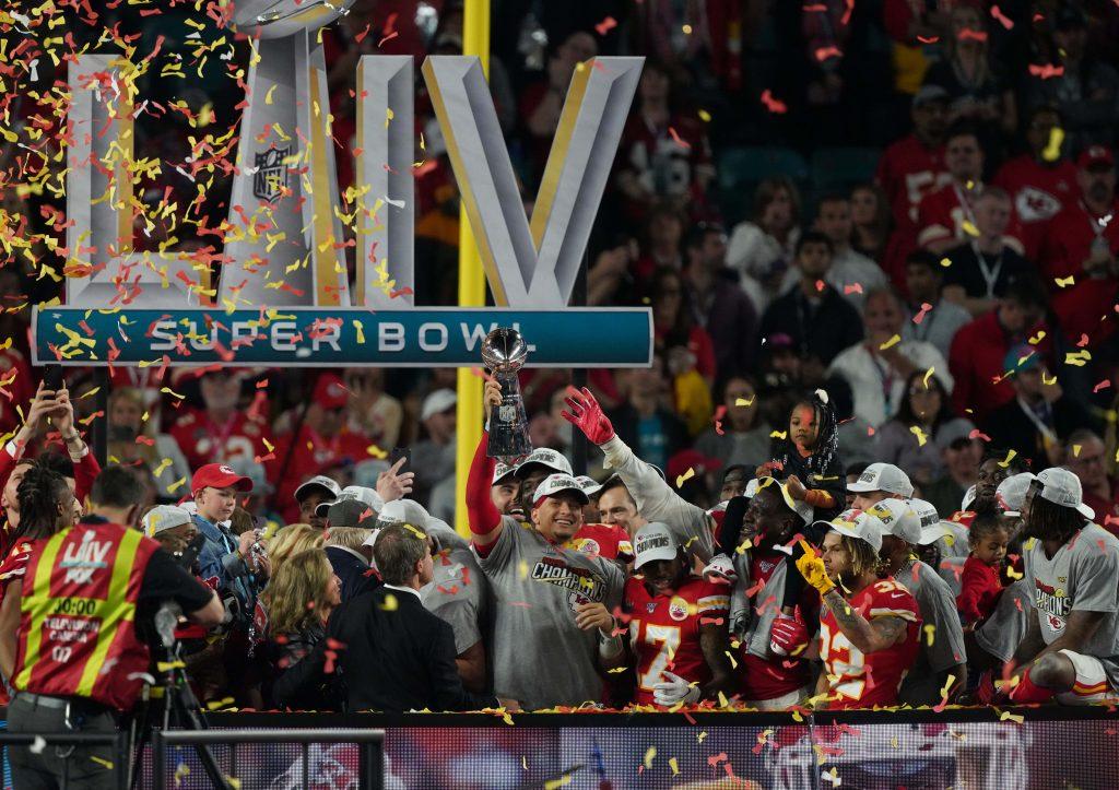 Kansas City Chiefs quarterback Patrick Mahomes (15) hoist the Vince Lombardi Trophy after defeating the San Francisco 49ers in Super Bowl LIV at Hard Rock Stadium.