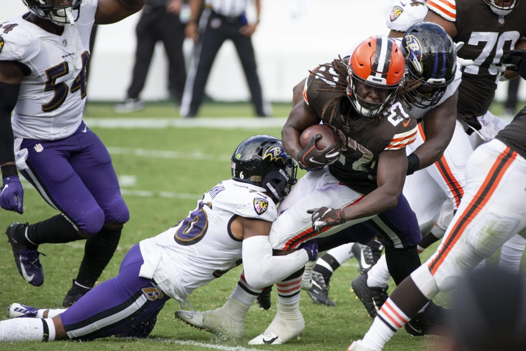 The Baltimore Ravens bring down Kareem Hunt of the Cleveland Browns