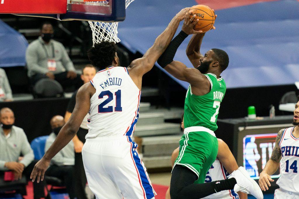 Joel Embiid of the Philadelphia 76ers and Jaylen Brown of the Boston Celtics