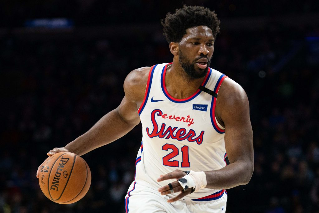 Philadelphia 76ers center Joel Embiid (21) dribbles the ball against the Memphis Grizzlies