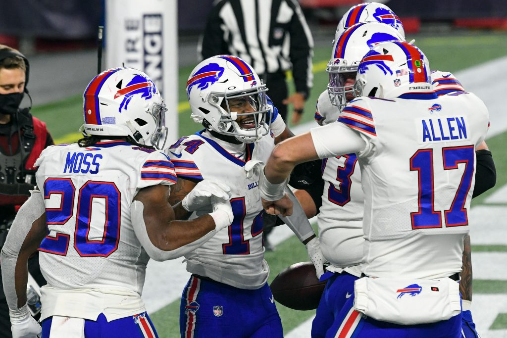 Dec 28, 2020; Foxborough, Massachusetts, USA; Buffalo Bills wide receiver Stefon Diggs (14) celebrates with quarterback Josh Allen (17) and running back Zack Moss (20) after scoring a touch down against the New England Patriots during the second half at Gillette Stadium. Mandatory Credit: Brian Fluharty-USA TODAY Sports
