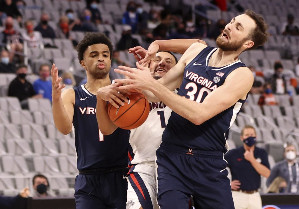 Virginia Cavaliers forward Jay Huff fights for a ball during loss to Gonzaga