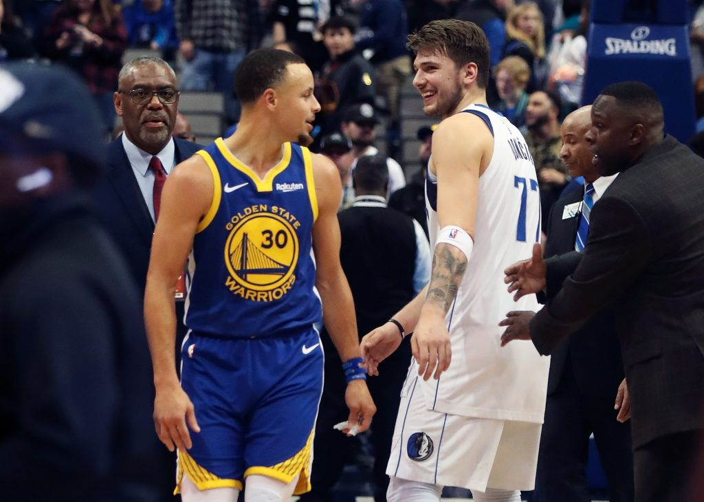 Golden State Warriors guard Stephen Curry and Dallas Mavericks guard Luka Doncic talk after game