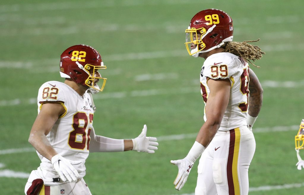 Washington Football Team tight end Logan Thomas (82) congratulates defensive end Chase Young (99) on a defensive stop against the Pittsburgh Steelers during the second quarter at Heinz Field.