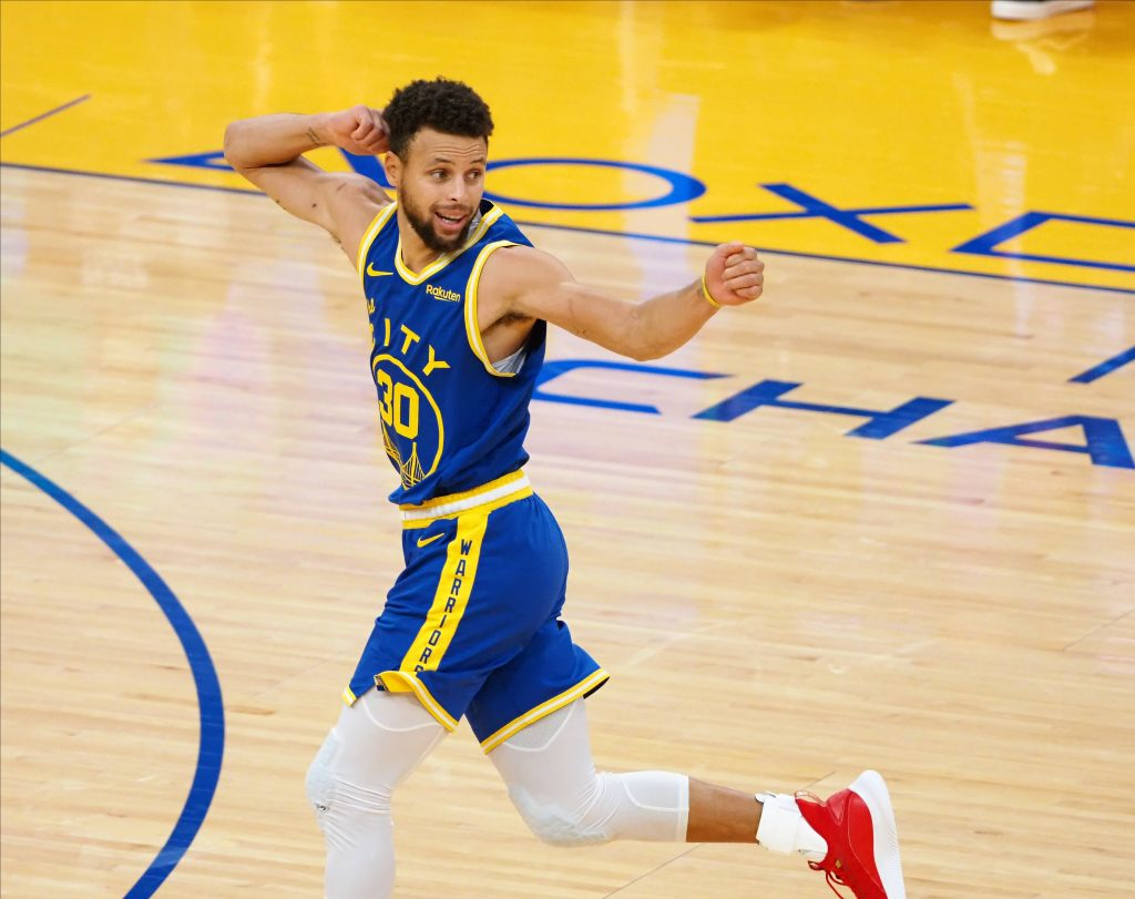 Golden State Warriors guard Stephen Curry celebrating