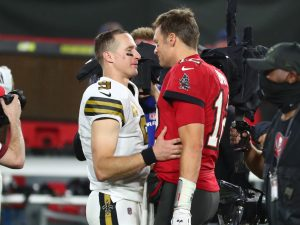 New Orleans Saints quarterback Drew Brees (9) and Tampa Bay Buccaneers quarterback Tom Brady (12) greet after the game at Raymond James Stadium.