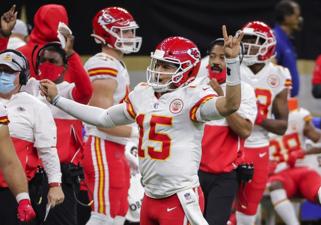 Kansas City Chiefs quarterback Patrick Mahomes (15) celebrates after a score against the New Orleans Saints during the second half at the Mercedes-Benz Superdome.