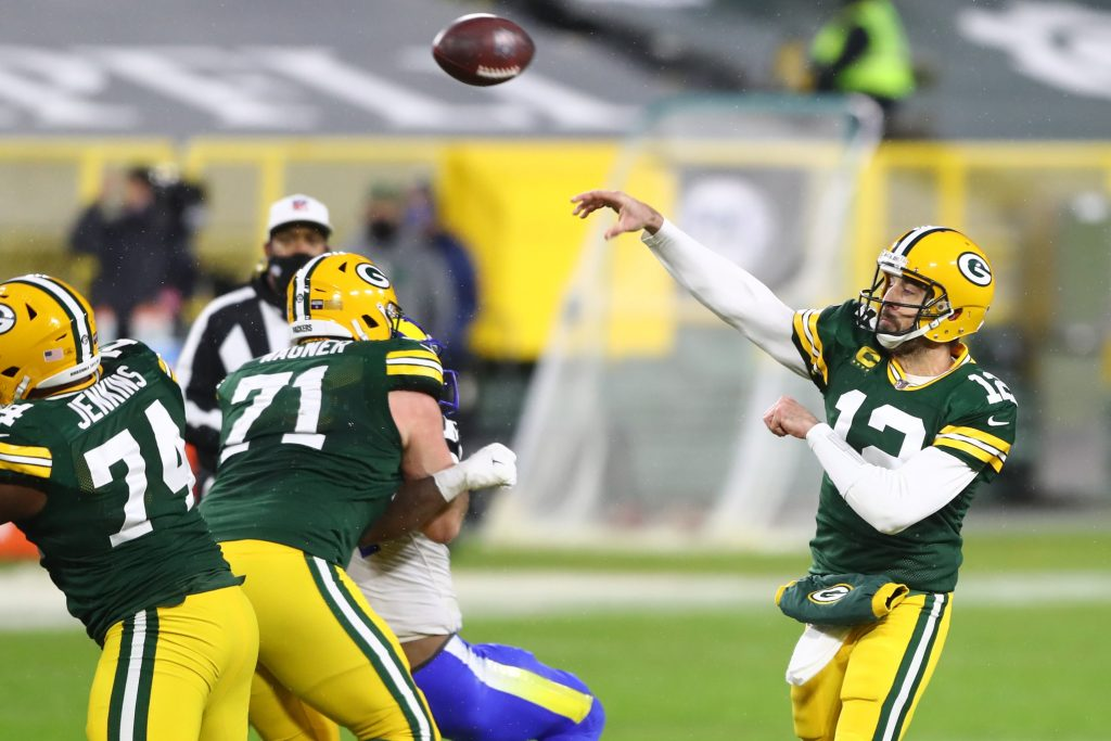 Green Bay Packers quarterback Aaron Rodgers drops back to pass during divisional round win over Los Angeles Rams