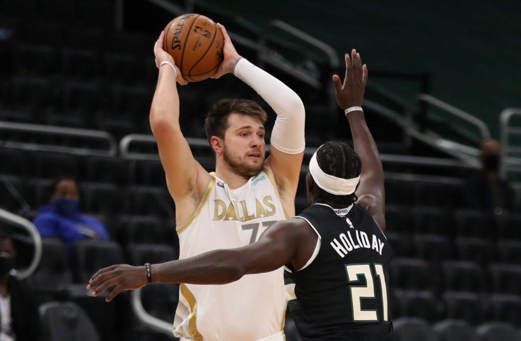 Dallas Mavericks forward Luka Doncic looking for a pass