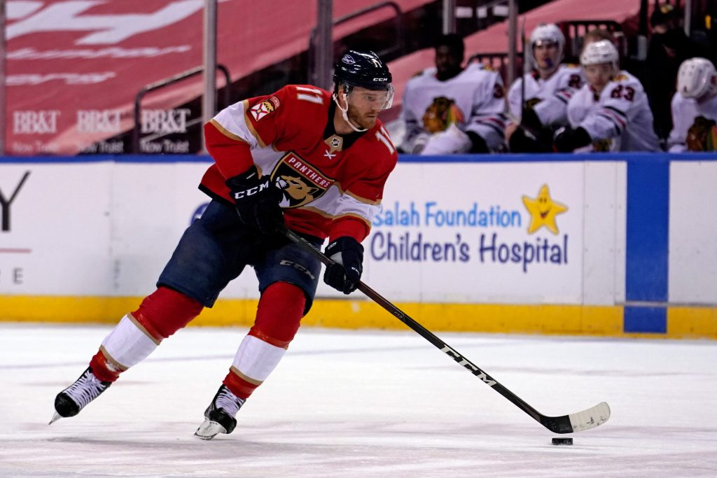Jan 17, 2021; Sunrise, Florida, USA; Florida Panthers left wing Jonathan Huberdeau (11) skates with the puck during the second period against the Chicago Blackhawks at BB&T Center.