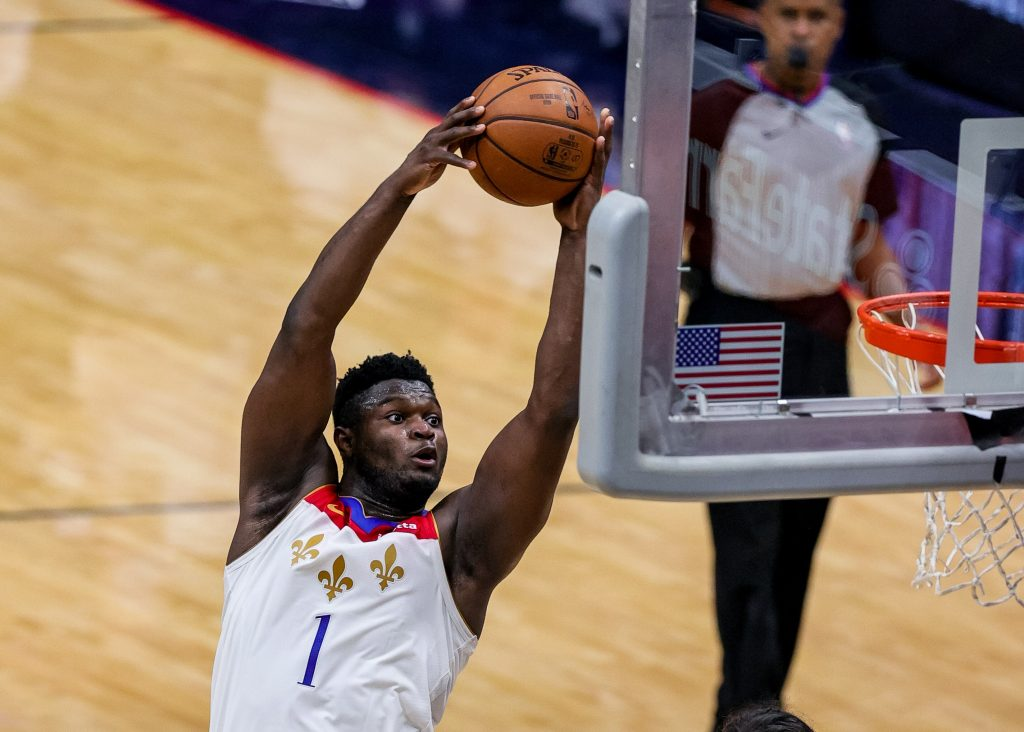 New Orleans Pelicans forward Zion Williamson (1) dunks the ball against Charlotte Hornets guard Terry Rozier (3) during the third quarter at Smoothie King Center.
