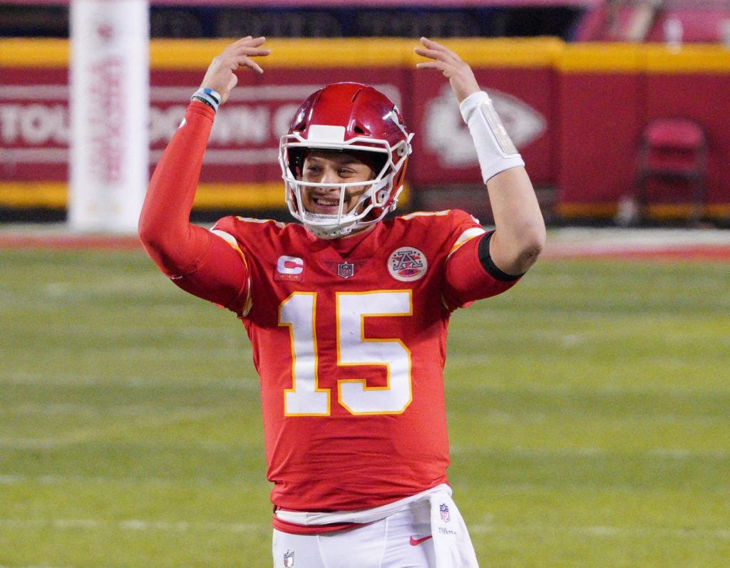 Kansas City Chiefs quarterback Patrick Mahomes (15) celebrates during the fourth quarter in the AFC Championship Game against the Buffalo Bills at Arrowhead Stadium.