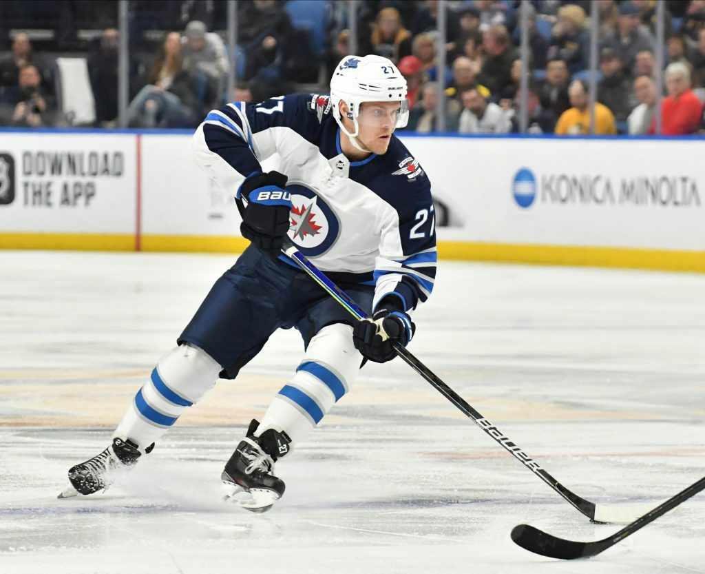 Feb 23, 2020; Buffalo, New York, USA; Winnipeg Jets left wing Nikolaj Ehlers (27) handles the puck against the Buffalo Sabres in the first period at KeyBank Center.