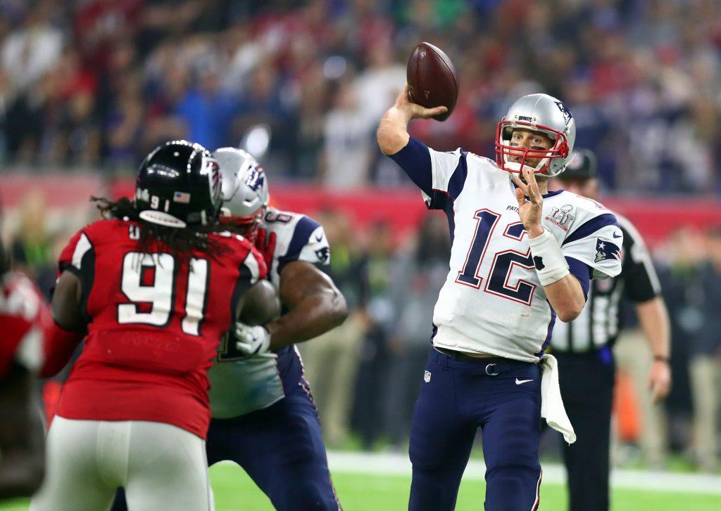 New England Patriots quarterback Tom Brady (12) throws a pass against the Atlanta Falcons in overtime during Super Bowl LI at NRG Stadium.